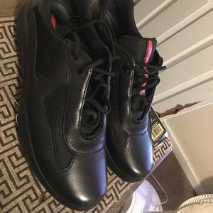 All black Prada's size 10